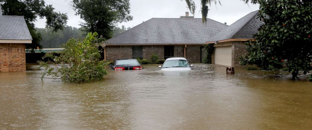 PHOTO: Houses and cars are seen partially submerged by flood waters from tropical storm Harvey in east Houston, Aug. 28, 2017.