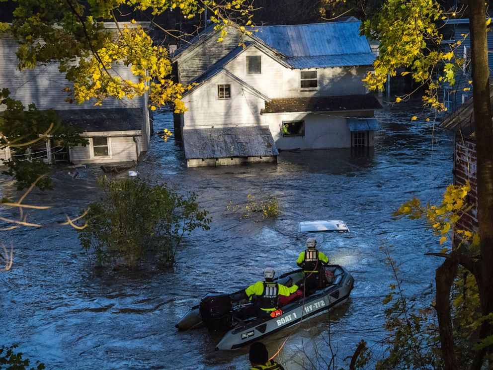 PHOTO: In this photo provided by the New York State Governors Office, a man looks from a window of a house being flooded by rising waters of the East Canada Creek as police arrive in a rescue boat, Friday, Nov. 1, 2019 in Dolgeville, N.Y.