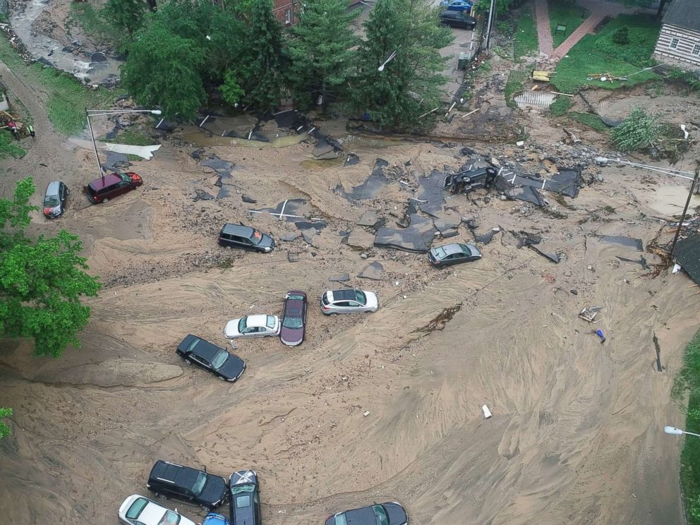 PHOTO: This image made from video provided by DroneBase shows vehicles swept by floodwater near the intersection of Ellicott Mills Drive and Main Street in Ellicott City, Md., May 28, 2018. Missing National Guardsman was trying to rescue woman when swept away in floodwaters: 'He's a hero' Missing National Guardsman was trying to rescue woman when swept away in floodwaters: 'He's a hero' flooding 1 ap er 180529 hpMain 4x3 992