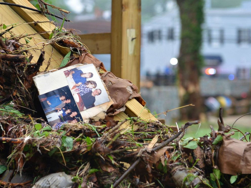 PHOTO: Family photos rest among debris after flash flooding in Ellicott City, Md., May 28, 2018.  Missing National Guardsman was trying to rescue woman when swept away in floodwaters: 'He's a hero' Missing National Guardsman was trying to rescue woman when swept away in floodwaters: 'He's a hero' flooding 3 ap er 180529 hpMain 4x3 992