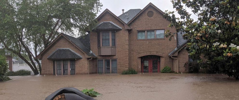 PHOTO: Floodwaters surround homes in Fort Smith, Ark., Wednesday, May 29, 2019. Floodwaters from the Arkansas River continue to rise.