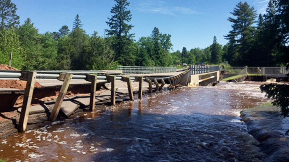 This photo provided by the Wisconsin Department of Transportation shows Wisconsin Highway 35 over Black River damaged from flash flooding in Pattison State Park in Douglas County, Wis., June 18, 2018.
