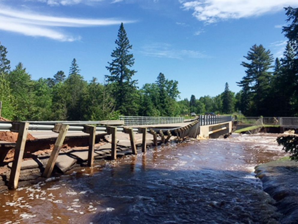 PHOTO: This photo provided by the Wisconsin Department of Transportation shows Wisconsin Highway 35 over Black River damaged from flash flooding in Pattison State Park in Douglas County, Wis., June 18, 2018.