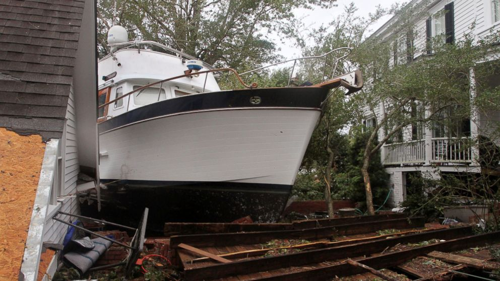 A 40-foot yacht lies in the yard of a storm-damaged home on East Front Street in New Bern, N.C., Saturday, Sept. 15, 2018. The boat washed up with storm surge and debris from Hurricane Florence.