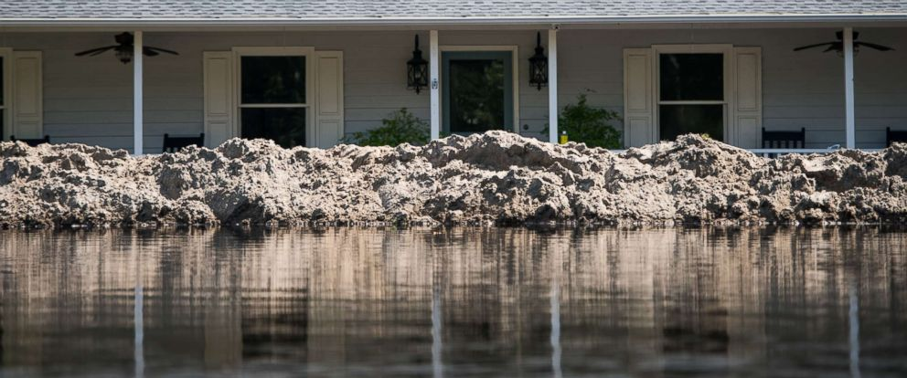 PHOTO: A home with a temporary levee is surrounded by floodwaters caused by Hurricane Florence near the Waccamaw River, Sept. 23, 2018 in Conway, S.C.