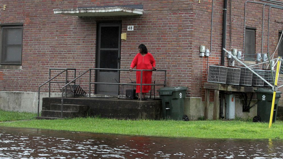 Residents at Trent Court Apartments wait out the weather as rising water gets closer to their doors in New Bern, N.C., Sept. 13, 2018.