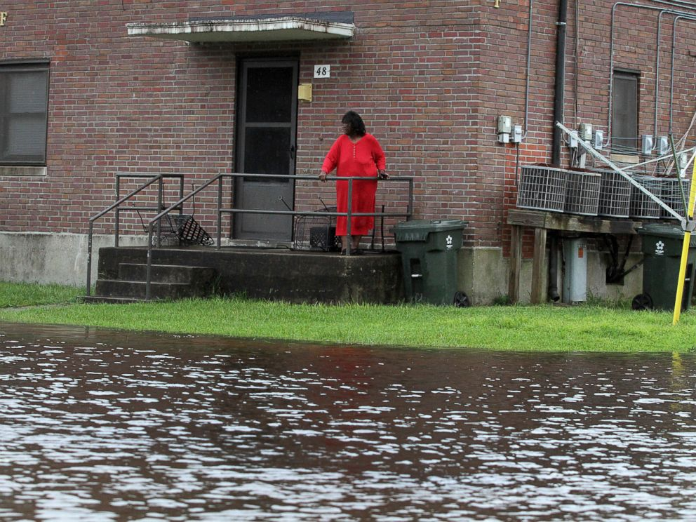 PHOTO: Residents at Trent Court Apartments wait out the weather as rising water gets closer to their doors in New Bern, N.C., Sept. 13, 2018.