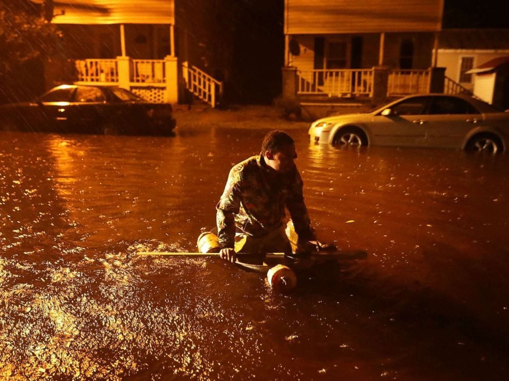 PHOTO: Michael Nelson floats in a boat made from a metal tub and fishing floats after the Neuse River went over its banks and flooded his street during Hurricane Florence Sept. 13, 2018 in New Bern, N.C.