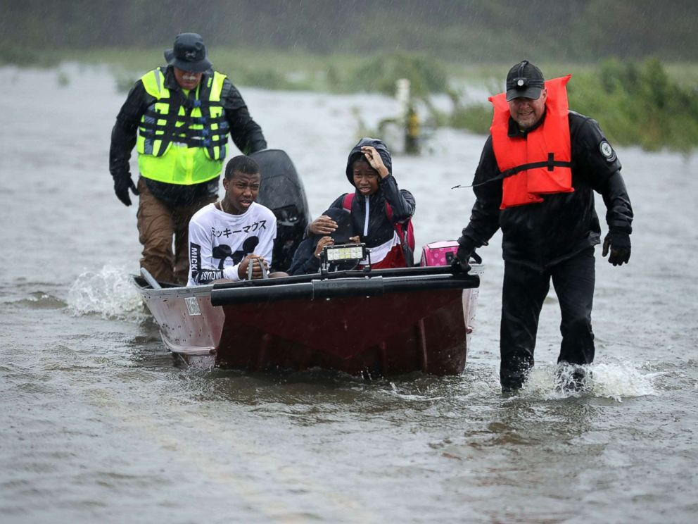 PHOTO: Volunteers from the Civilian Crisis Response Team help rescue three children from their flooded home, Sept. 14, 2018, in James City, N.C.