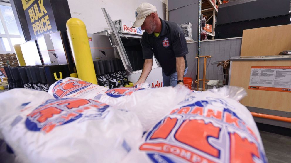 Mike Herring with Frank's Ice Company unloads another pallet of ice as people buy supplies at The Home Depot on Monday, Sept. 10, 2018, in Wilmington, N.C.
