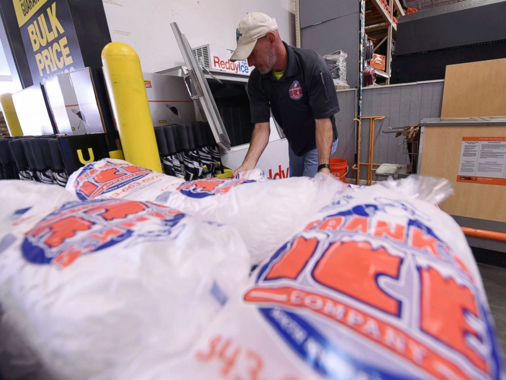 PHOTO: Mike Herring with Franks Ice Company unloads another pallet of ice as people buy supplies at The Home Depot on Monday, Sept. 10, 2018, in Wilmington, N.C.