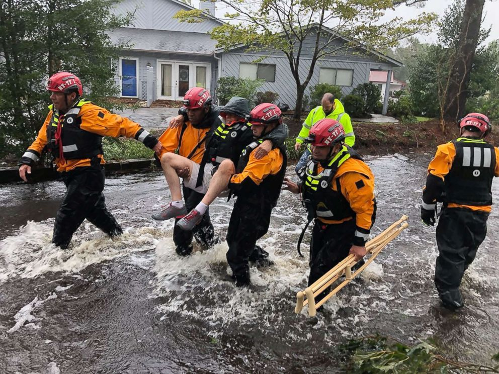 PHOTO: Search and Rescue workers from New York rescue a man from flooding caused by Hurricane Florence in River Bend, N.C., Sept. 14, 2018.