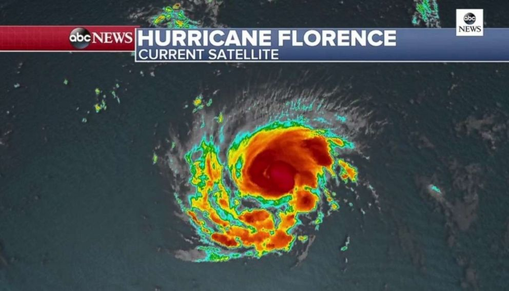 PHOTO: Florence continues to strengthen and an eye is beginning to form which is now visible on satellite.