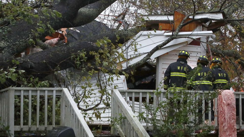 Firefighters arrive at a home where a large tree fell trapping people inside, after Hurricane Florence hit the area, Sept. 14, 2018 in Wilmington, N.C. A mother and infant died, and the father was transported  with injuries.