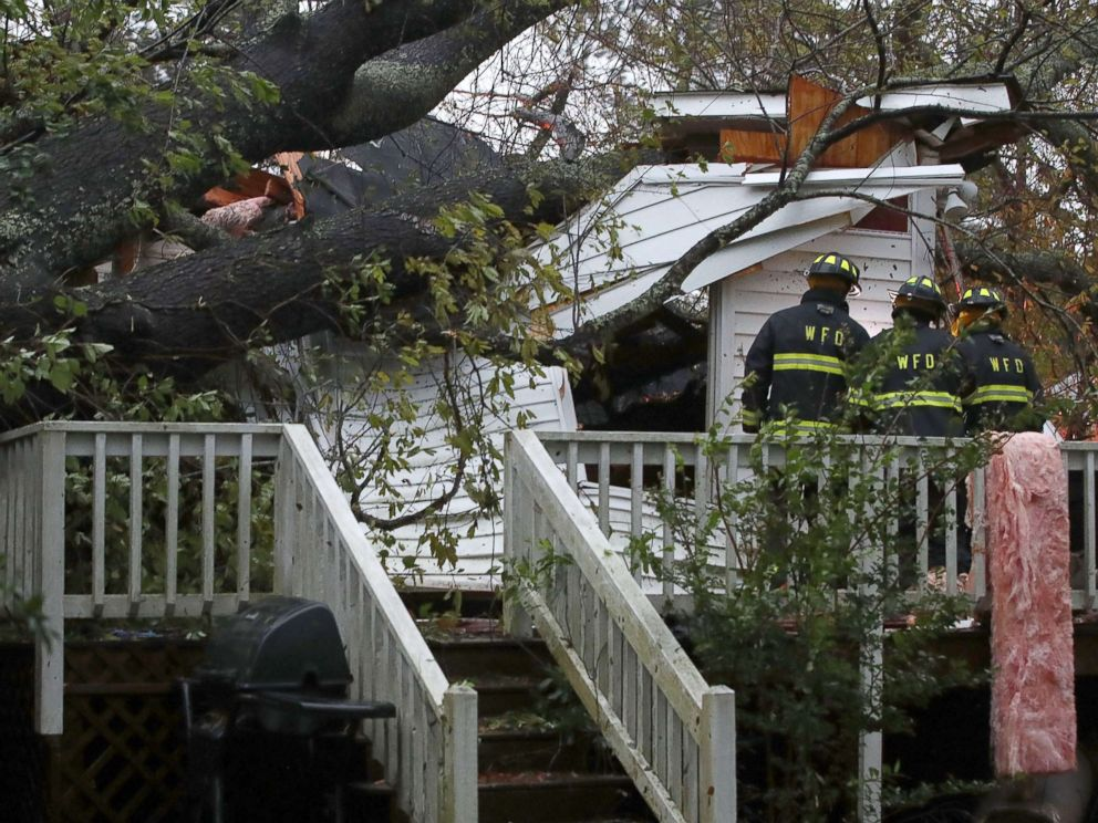 PHOTO: Firefighters arrive at a home where a large tree fell trapping people inside, after Hurricane Florence hit the area, Sept. 14, 2018 in Wilmington, N.C.