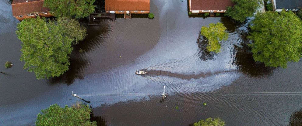 PHOTO: Two people in a canoe paddle through a street that was flooded by Hurricane Florence north of New Bern, N.C. on Sept. 15, 2018. Storm surge and heavy flooding from the hurricane has inundated much of Eastern North Carolina.