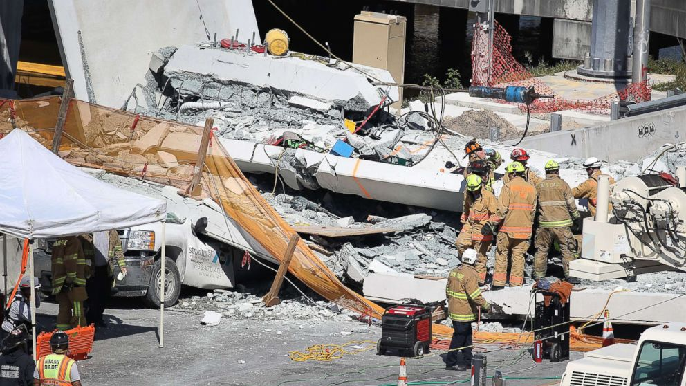 Miami-Dade Fire Rescue Department personnel and other rescue units work at the scene where a pedestrian bridge collapsed at Florida International University on March 15, 2018 in Miami.