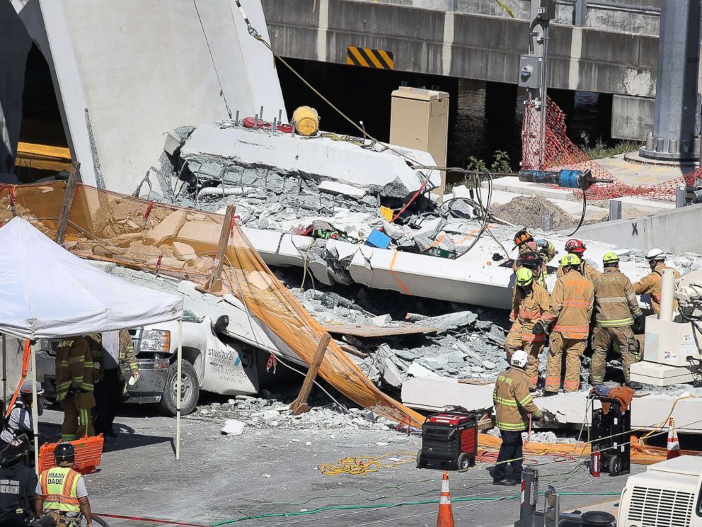 PHOTO: Miami-Dade Fire Rescue Department personnel and other rescue units work at the scene where a pedestrian bridge collapsed at Florida International University on March 15, 2018 in Miami.