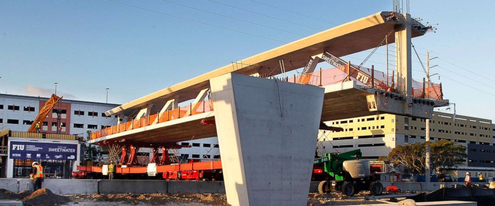 PHOTO: This March 10, 2018 image shows an early morning view of the main span of the a pedestrian bridge as it was being positioned to connect the City of Sweetwater, Fla., to Florida International University near Miami.
