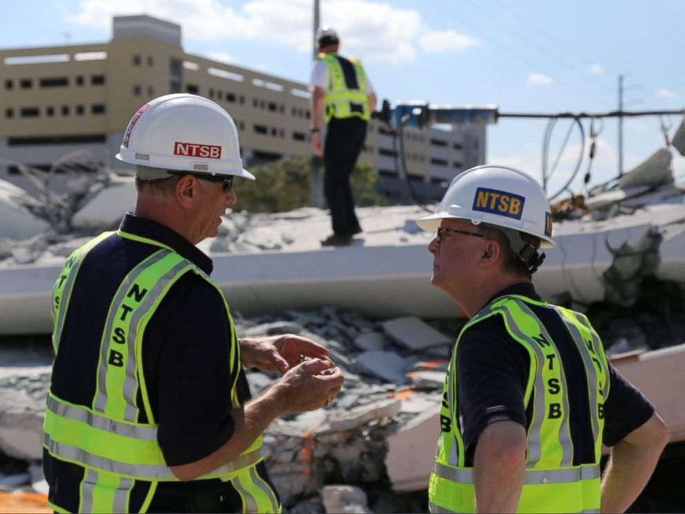 PHOTO: NTSB examine the debris from Thursdays collapse of a bridge on FIUs campus, March 16, 2018 in Miami.