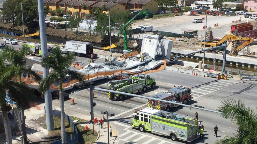 Emergency personnel responds to a collapsed pedestrian bridge connecting Florida International University on March 15, 2018 in the Miami area. The  brand-new pedestrian bridge collapsed onto a highway crushing at least five vehicles.