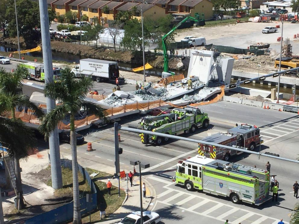 PHOTO: Emergency personnel responds to a collapsed pedestrian bridge connecting Florida International University on March 15, 2018 in the Miami area. The brand-new pedestrian bridge collapsed onto a highway crushing at least five vehicles.
