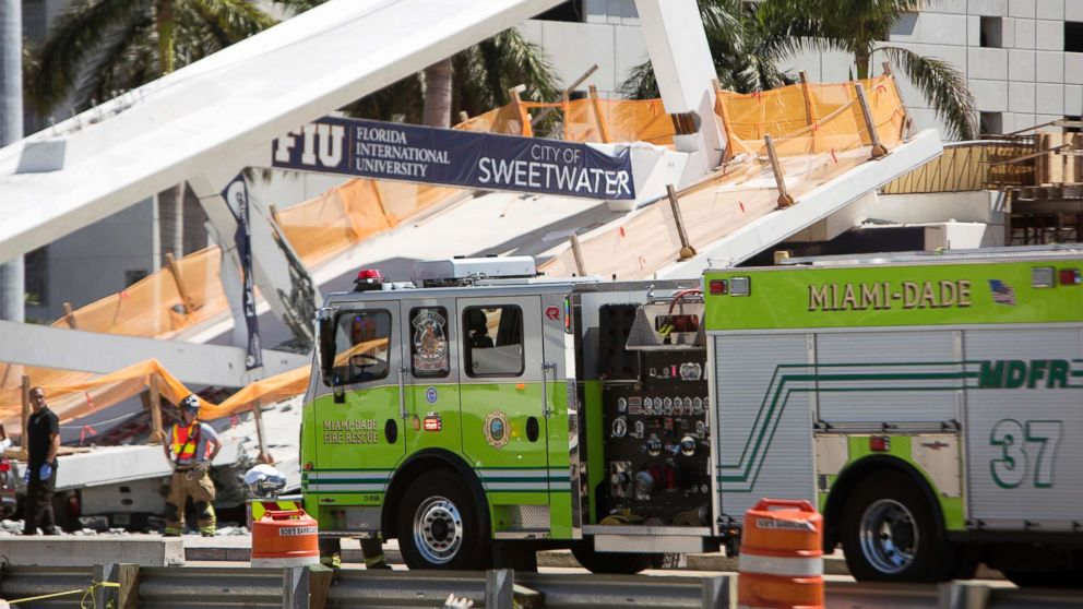 Emergency personnel responds to a collapsed pedestrian bridge connecting Florida International University on March 15, 2018 in the Miami area.