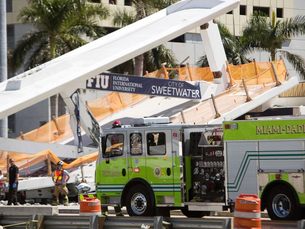 PHOTO: Emergency personnel responds to a collapsed pedestrian bridge connecting Florida International University on March 15, 2018 in the Miami area.