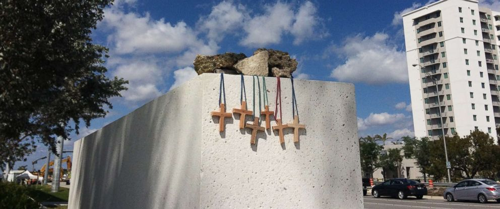 PHOTO: Six crosses are placed at a makeshift memorial on the Florida International University campus in Miami, March 17, 2018, near the scene of a pedestrian bridge collapse on March 15.