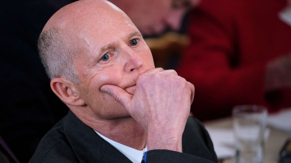 Florida Governor Rick Scott listens to a speaker at the White House on Feb. 26, 2018 in Washington.