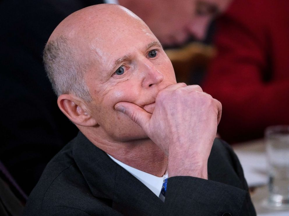 PHOTO: Florida Governor Rick Scott listens to a speaker at the White House on Feb. 26, 2018 in Washington.