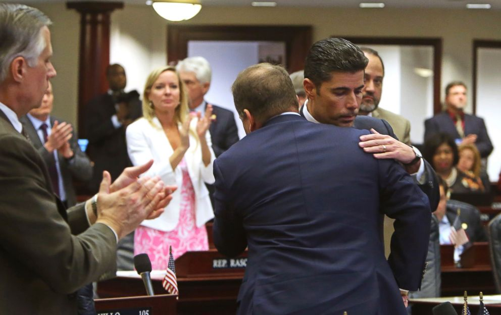 PHOTO: Rep. Jose Oliva, R- Miami Lakes, is hugged and congratulated by House members as the gun and school safety bill passed the Florida House 67-50 in Tallahassee, Fla.,March 7, 2018.