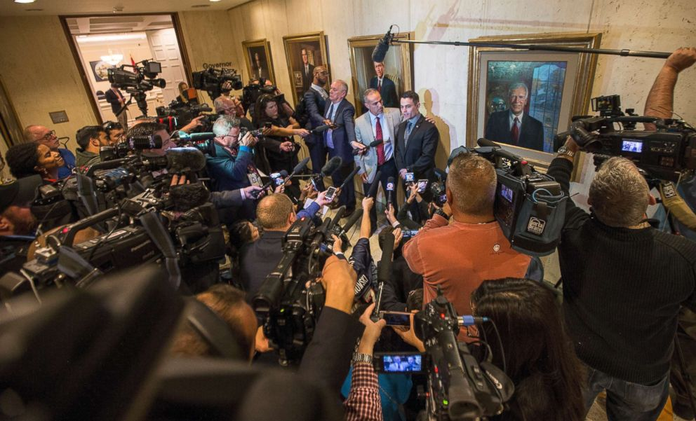 PHOTO:Andrew Pollack,and his son Hunter, center, speak to the media outside the governors office after the governor signed the Marjory Stoneman Douglas Public Safety Act at the Florida State Capitol in Tallahassee, Fla.,March 9, 2018.