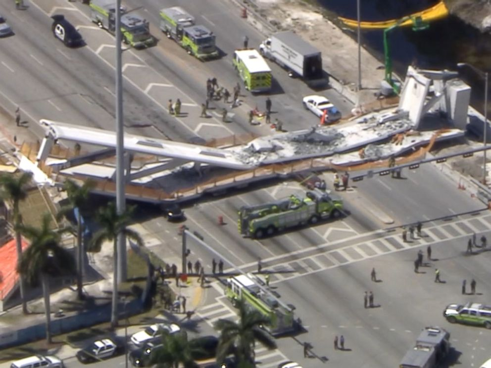 PHOTO: First responders were seen tending to injured victims on the scene of a pedestrian bridge that collapsed on the Florida International University campus.