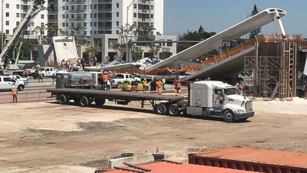 A pedestrian bridge collapses at the Florida International University, March 15, 2018, in Miami.