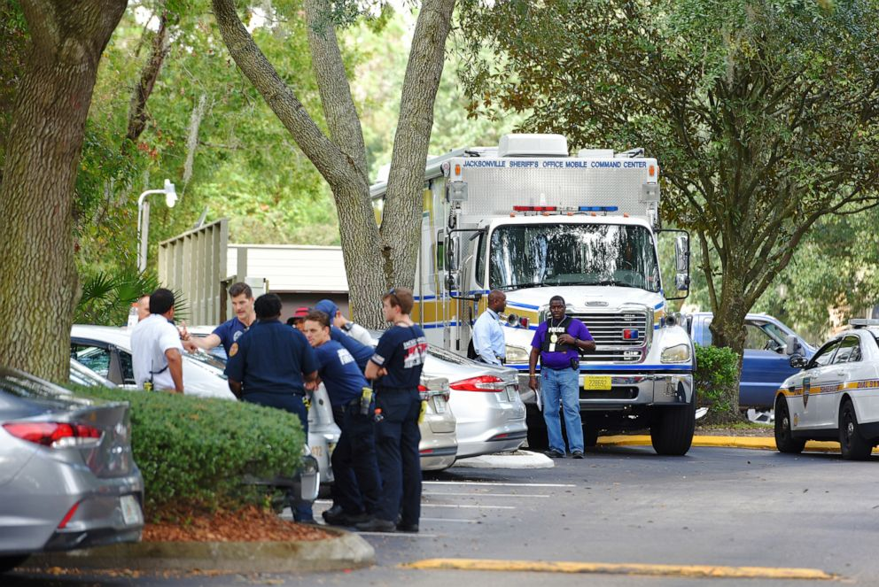 PHOTO: Law enforcement investigators with the JSO mobile command center in the Southside Villas apartment complex off Southside Blvd. in Jacksonville, Fla., Nov. 6, 2019.