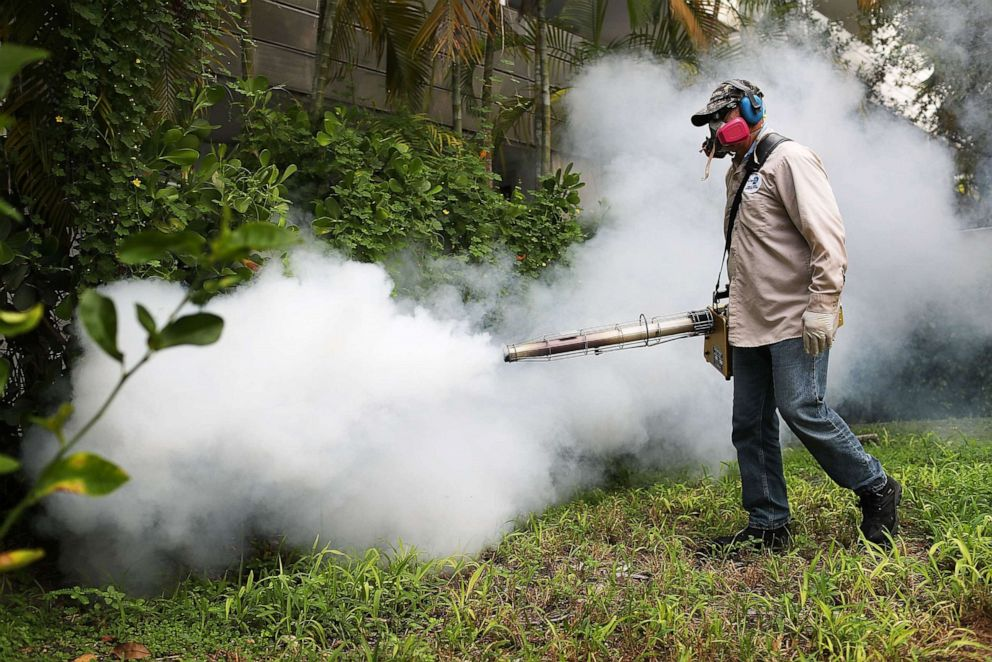 PHOTO: A Miami-Dade County mosquito control inspector sprays pesticide to kill mosquitoes in the Miami Beach neighborhood on Aug. 24, 2016 in Miami Beach, Fla.