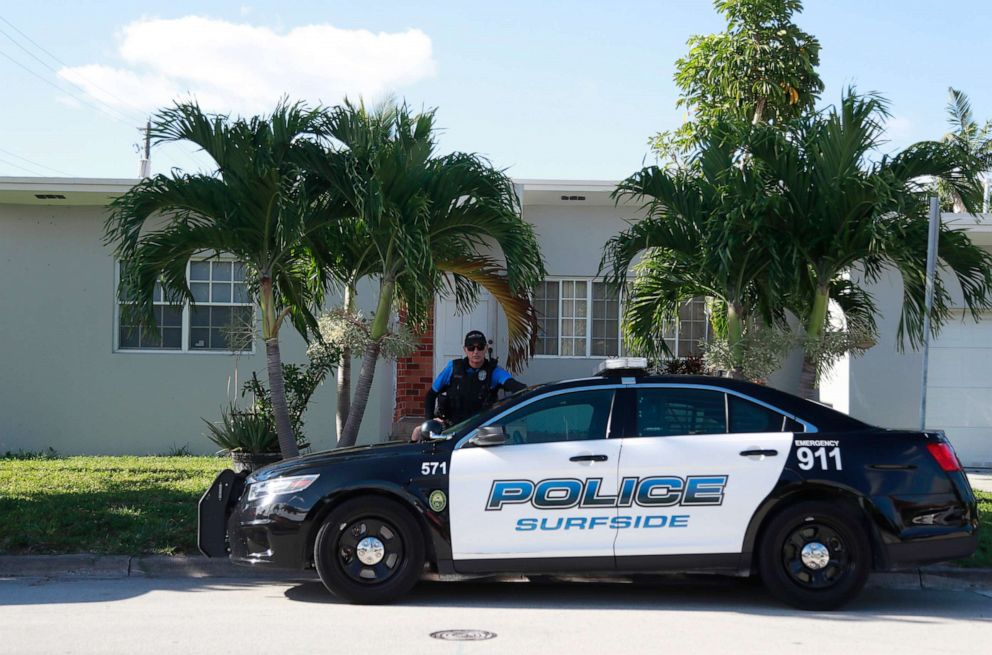 PHOTO: A police officer stands guard in front of the home of Sol Pais, April 17, 2019, in Surfside, Fla.
