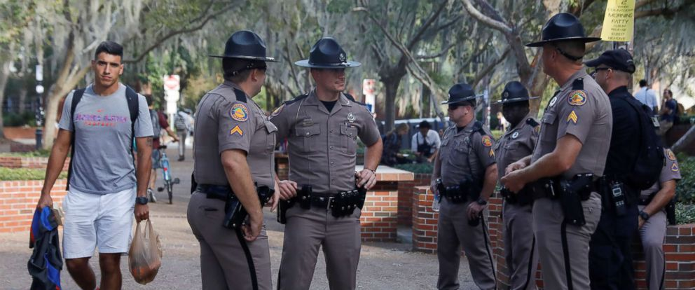 PHOTO: Florida Highway Patrol officers stand guard the day before a speech by Richard Spencer, an avowed white nationalist, on the campus of the University of Florida in Gainesville, Fla., Oct. 18, 2017.