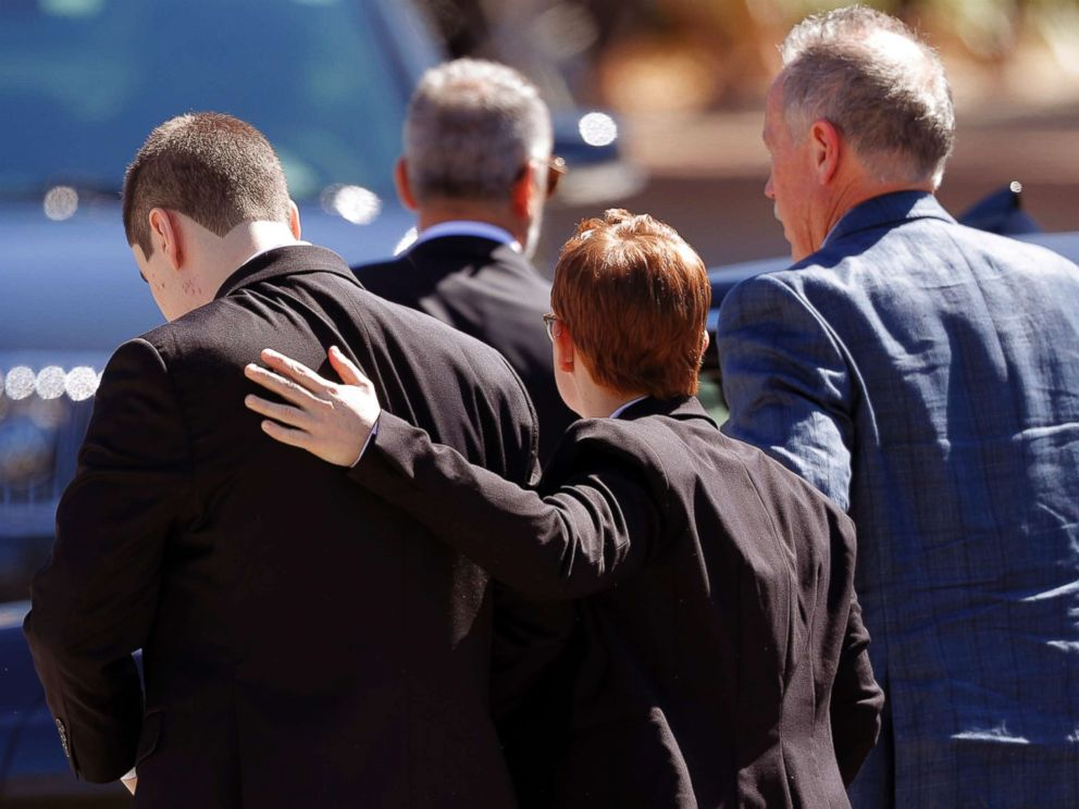 PHOTO: Family and friends console each other as they arrive for the funeral of Meadow Pollack, a victim of the Wednesday shooting at Marjory Stoneman Douglas High School, in Parkland, Fla., Feb. 16, 2018.