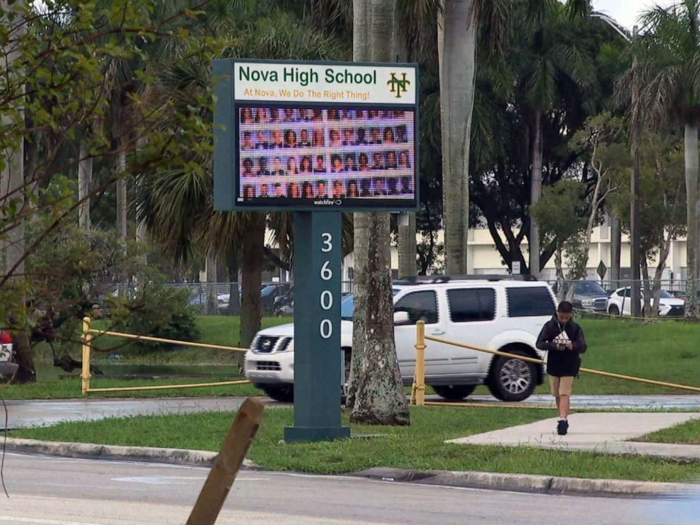 PHOTO: People pass by the entrance to Nova High School in Davie, Fla., Aug. 22, 2019.