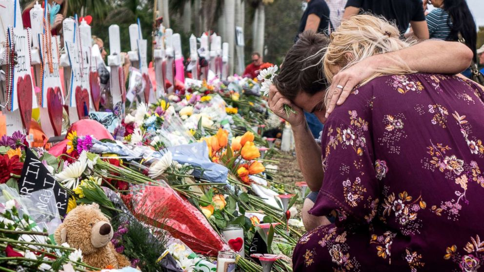 People visit a makeshift memorial in front of the Marjory Stoneman Douglas High School in, Parkland, Florida, Feb. 20, 2018. Residents in the community honor victims of a mass shooting that took place at Marjory Stoneman Douglas High School on Feb. 14, that left 17 dead.