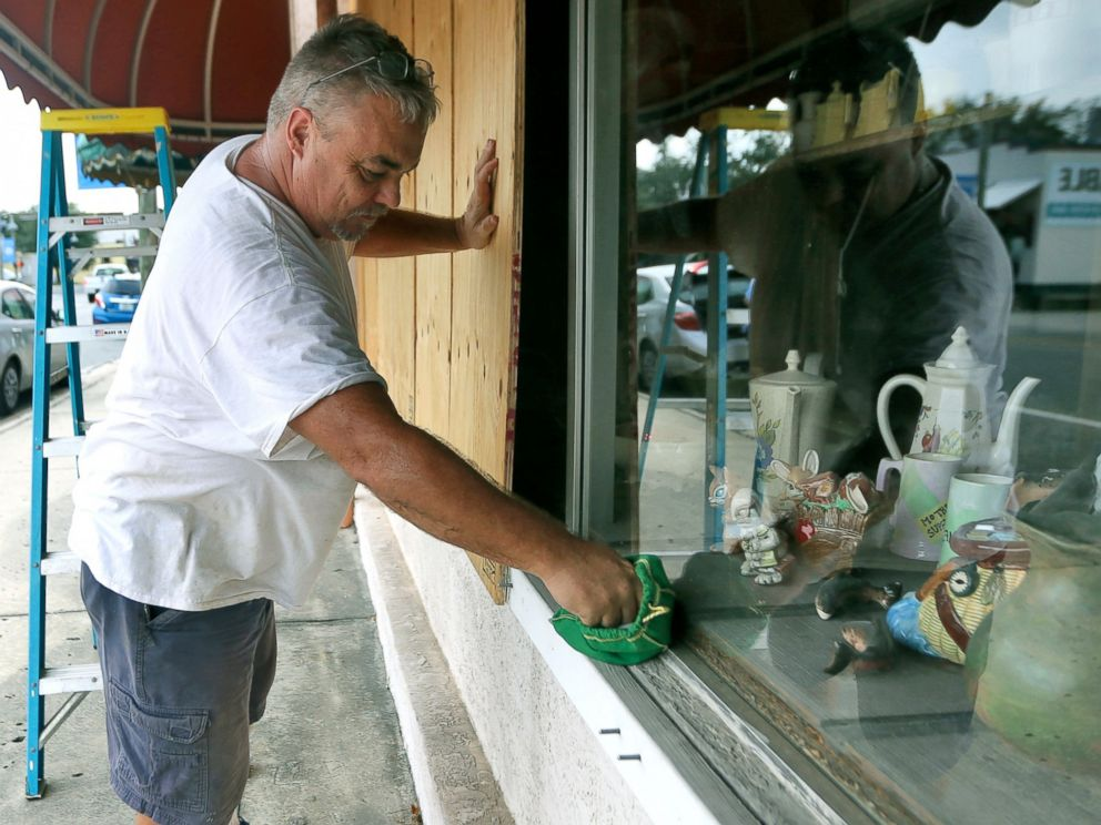 PHOTO: Bobby Smith boards up the windows at Janis Ceramics in Panama City, Fla., on Monday, Oct. 8, 2018, in preparation for the arrival of Hurricane Michael.