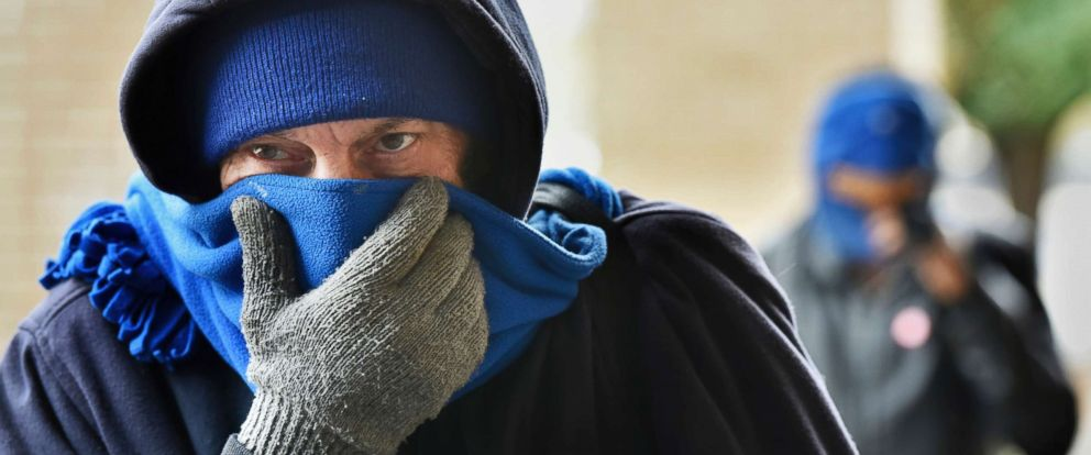 PHOTO: Chris McGuire tries to stay warm as he waits for a space at the City Rescue Mission on Tuesday, Jan. 2, 2018, in Jacksonville, Fla.