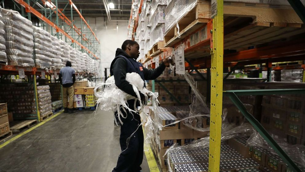 In this June 7, 2017 file photo Employee Shawn Lewis moves pallets of food at the Food Bank for New York City in the Bronx neighborhood of Hunts Point, in N.Y.