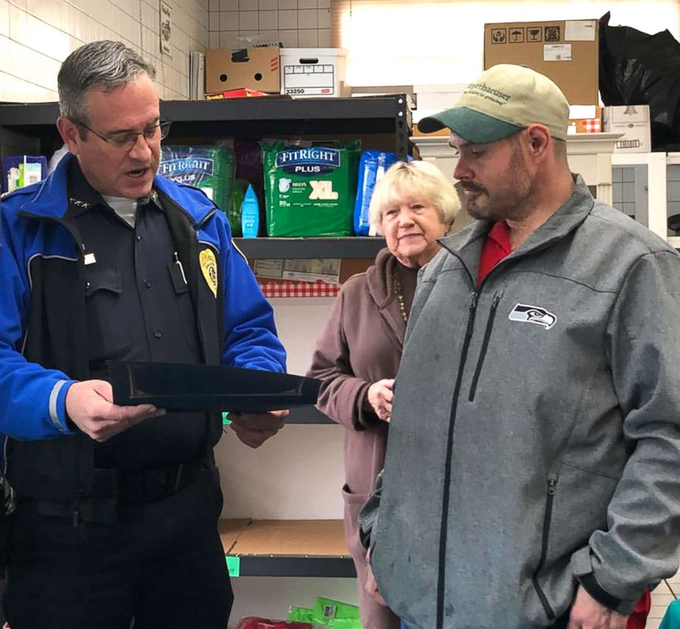 PHOTO: Chief Brad Moericke presents Kevin with a Police Chief citation at Sumner Community Food Bank, Nov., 29, 2018.