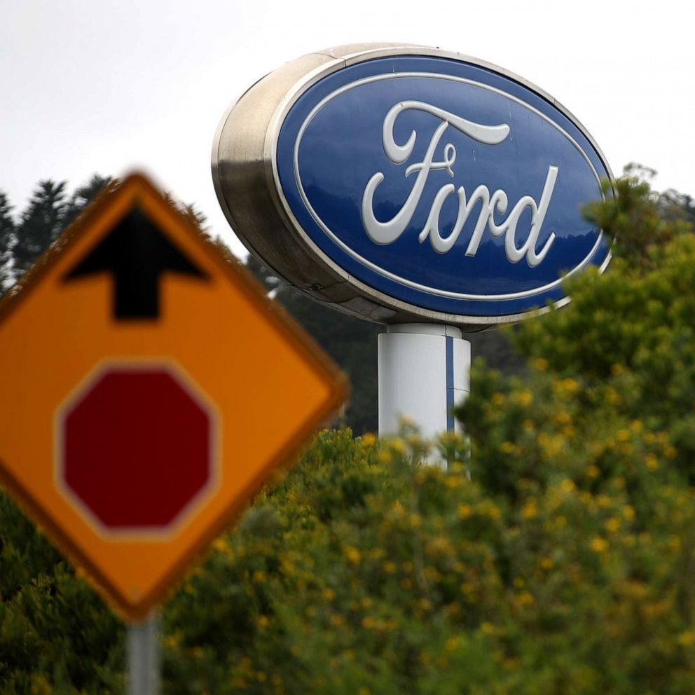 PHOTO: A sign with the Ford logo is posted in front of a dealership in Northern California, May 20, 2019.