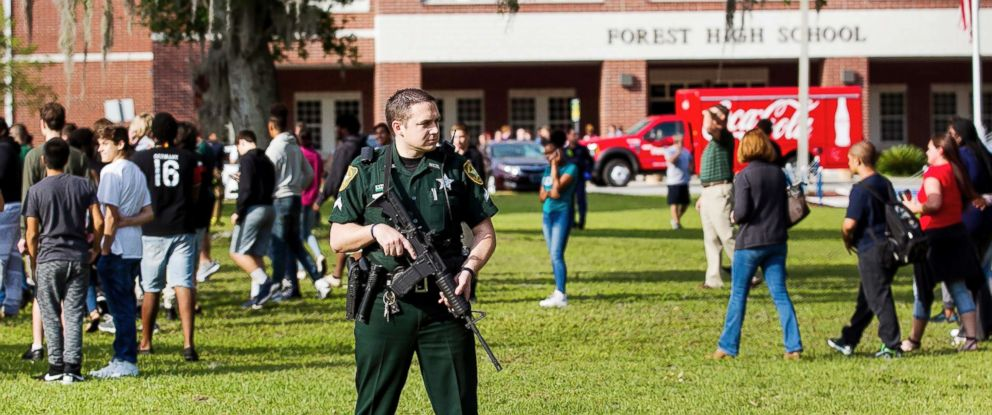 PHOTO: A Marion County Sheriffs Deputy stands outside Forest High School as students exit the school after a school shooting occurred on April 20, 2018 in Ocala, Fla.