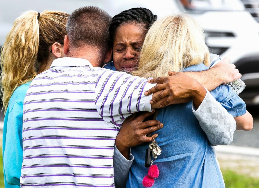 PHOTO: Nikki Brown, center, hugs others in front of Forest High School on April 20, 2018 in Ocala, Fla.