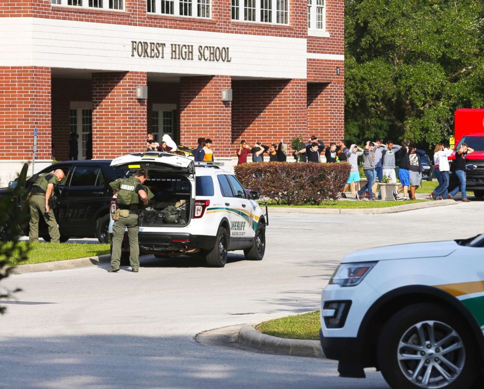 PHOTO: Students are led out of Forest High School as law enforcement agents prepare to enter the school on April 20, 2018, in Ocala, Fla.